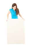Young woman looking at empty billboard Royalty Free Stock Photography