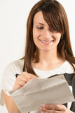 Young woman looking in an envelope Stock Photography