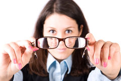 Young woman looking through eyeglasses Stock Image