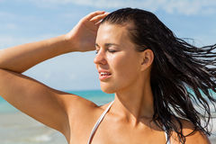Young woman looking far away in the beach Royalty Free Stock Photography