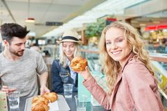 Young woman is looking forward to a croissant stock photos