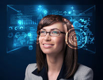 Young woman looking with futuristic smart high tech glasses Stock Photo