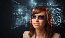 Young woman looking with futuristic smart high tech glasses. Concept Stock Photo