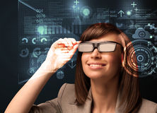 Young woman looking with futuristic smart high tech glasses. Concept Stock Images