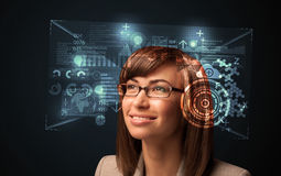 Young woman looking with futuristic smart high tech glasses. Concept Stock Image