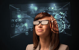 Young woman looking with futuristic smart high tech glasses. Concept Royalty Free Stock Image
