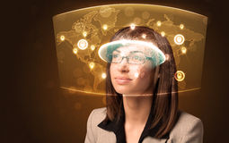 Young woman looking at futuristic social network map Stock Image
