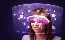 Young woman looking at futuristic social network map Royalty Free Stock Photo