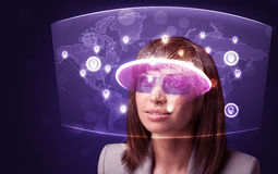 Young woman looking at futuristic social network map Royalty Free Stock Photography