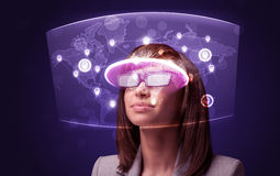 Young woman looking at futuristic social network map Stock Photos