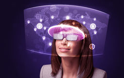 Young woman looking at futuristic social network map Royalty Free Stock Photos