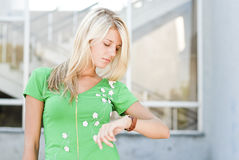 Young woman looking on hand watch Royalty Free Stock Images