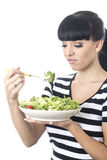 Young Woman Looking at Healthy Bowl of Green Salad Leaves with distaste Stock Photography