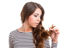 Young woman looking at her hair Royalty Free Stock Image