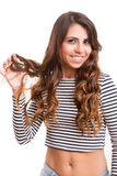 Young woman looking at her hair Stock Photos