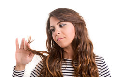 Young woman looking at her hair Royalty Free Stock Photography