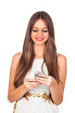 Young Woman Looking at Her Mobile Phone Royalty Free Stock Images
