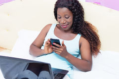Young woman looking her mobile phone royalty free stock image