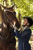 Young woman looking at horse with love royalty free stock photo