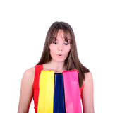 Young woman looking inside the shopping bags Royalty Free Stock Photo