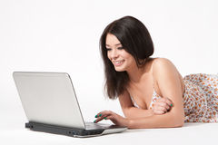 Young woman looking at laptop Stock Photo