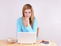 Young woman looking at laptop computer Stock Photos