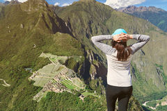 Young woman looking on Machu Picchu Royalty Free Stock Photos