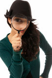 Young woman looking through magnifying glass stock photos