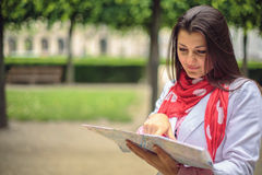 Young woman looking on the map at the city park Paris, France Stock Photo