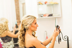 Young woman looking in a mirror. Real young woman looking in a mirror Stock Images