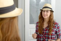 Young woman looking in a mirror. A young woman looking in a mirror Royalty Free Stock Photo