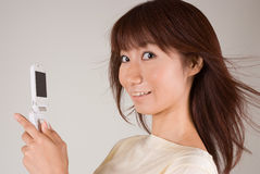 Young woman looking at mobile phone. Young woman smiling with mobile phone Royalty Free Stock Photography