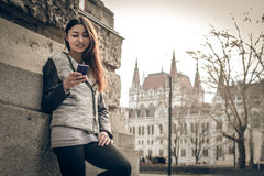 Young woman looking at the mobile phone Stock Images