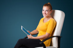 Young woman looking at modern tablet Royalty Free Stock Image