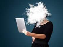 Young woman looking at modern tablet with abstract cloud Stock Photo