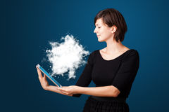 Young woman looking at modern tablet with abstract cloud Stock Image