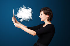Young woman looking at modern tablet with abstract cloud Stock Photography