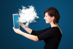 Young woman looking at modern tablet with abstract cloud Stock Images