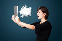 Young woman looking at modern tablet with abstract cloud Royalty Free Stock Photo