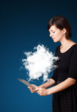 Young woman looking at modern tablet with abstract cloud Royalty Free Stock Image