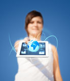 Young woman looking at modern tablet with abstract light and var Royalty Free Stock Photography