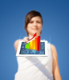 Young woman looking at modern tablet with abstract light and var Stock Photo