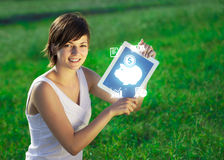 Young woman looking at modern tablet with abstract light and var Royalty Free Stock Photos