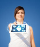 Young woman looking at modern tablet with abstract light and var Royalty Free Stock Images
