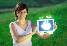 Young woman looking at modern tablet with abstract light and var Stock Image