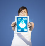 Young woman looking at modern tablet with abstract light and var Stock Photos