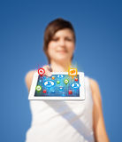 Young woman looking at modern tablet with abstract lights and so Royalty Free Stock Images