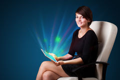 Young woman looking at modern tablet with abstract lights Stock Photography