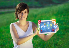 Young woman looking at modern tablet with abstract lights and so Stock Photo
