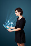 Young woman looking at modern tablet with abstract lights and so Stock Photography